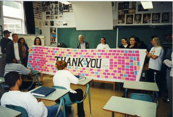 A few days after I posted this entry, it was seen by Catherine, Mr. Ratzlaff's daughter.  She sent me a picture of the banner (a photo I had never seen)...and sure enough, there we are: I'm holding the end on the left, my good friend Deanna is holding the end on the right, other students surround sending their love, and Mr. Ratzlaff is centre--with a smile we'll always remember.